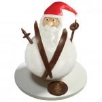 PÈRE LA BOULE  Sous son chocolat pâte d'amande, ce bonhomme de neige est garni de chocolats noir et lait, 42euros. À la mère de famille, 35, rue du faubourg Montmartre, 75009 Paris.  www.lameredefamille.com